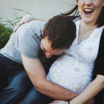 Young happy couple - woman is pregnant and expecting a baby